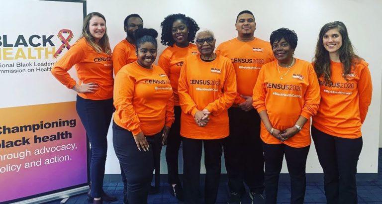 the census team wearing their orange t shirts